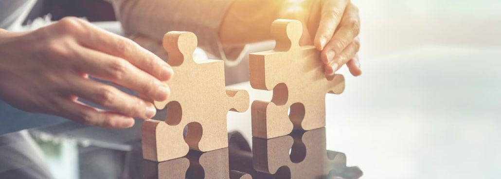 Image of a person connecting to puzzle pieces.