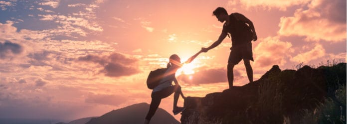 Inspiring Image of sunset and people helping each other