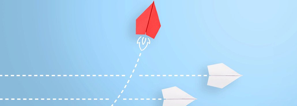 Photo of paper airplane going in a different direction.