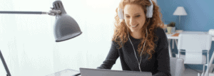 Woman sitting at a desk, learning online.